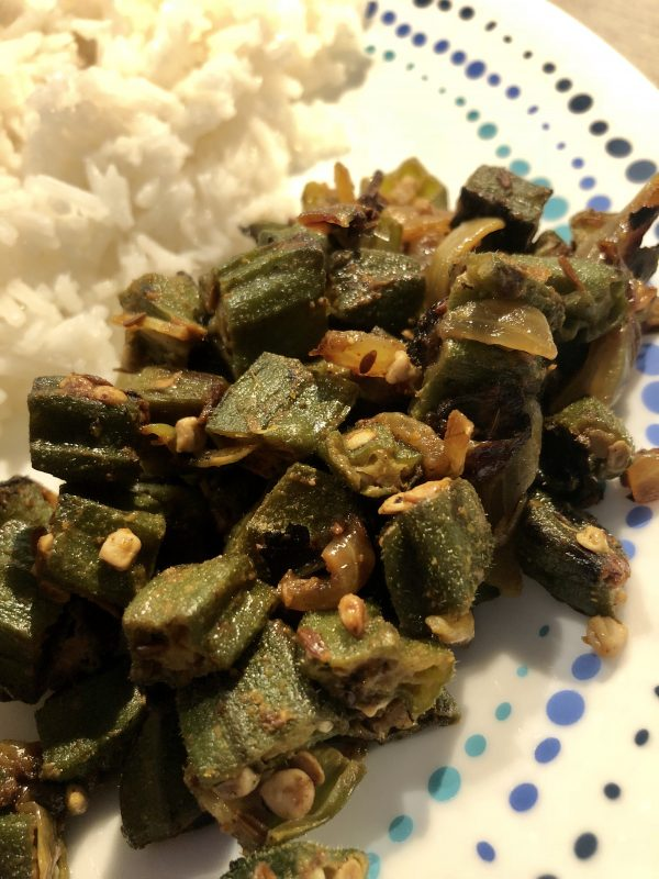 Plate with chopped masala okra served alongside rice.