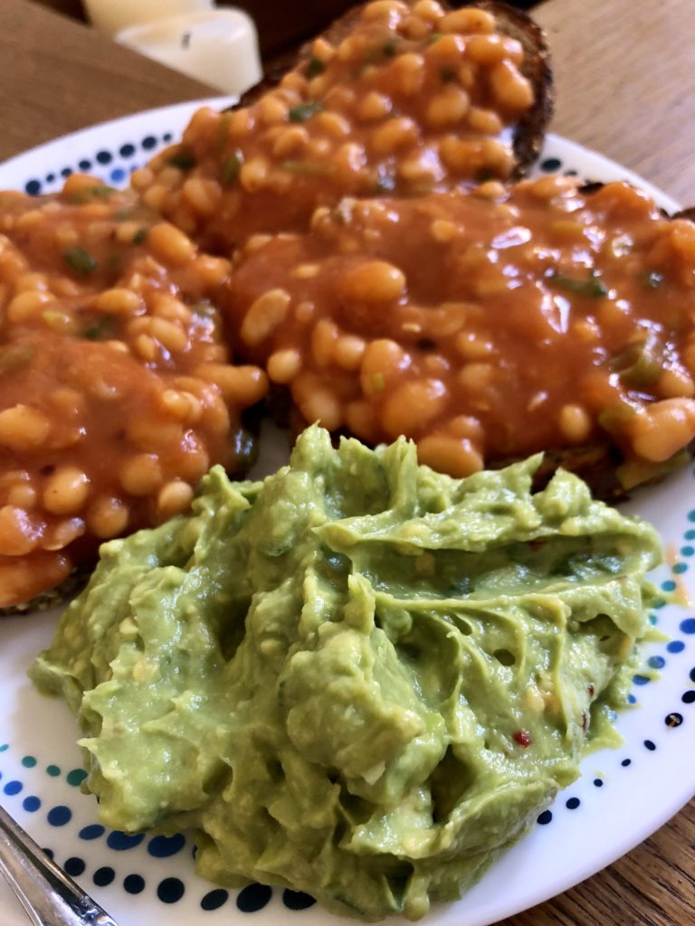 Masala baked beans on toast with smashed avocados