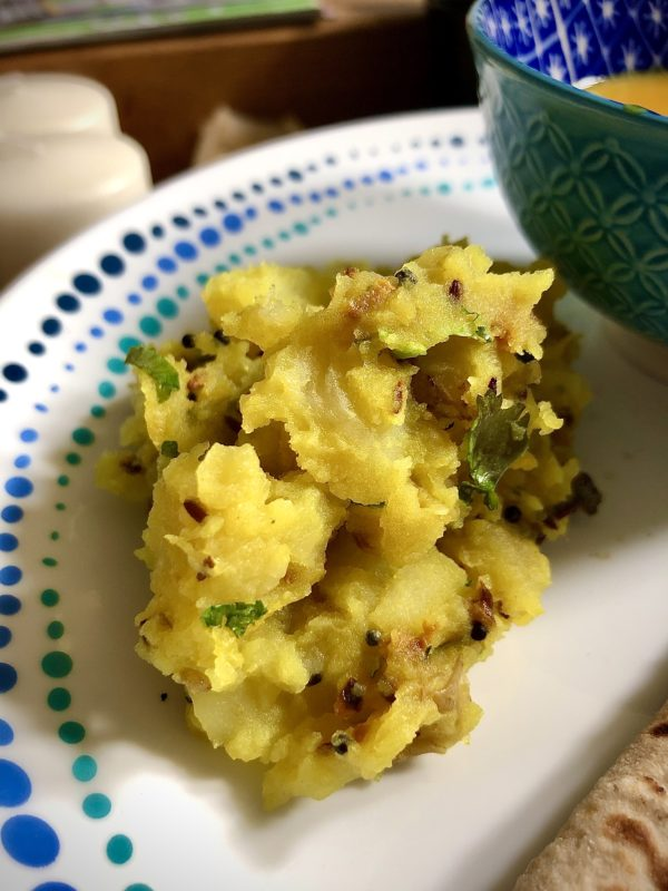 picnic potatoes with turmeric ginger garlic and green chillies