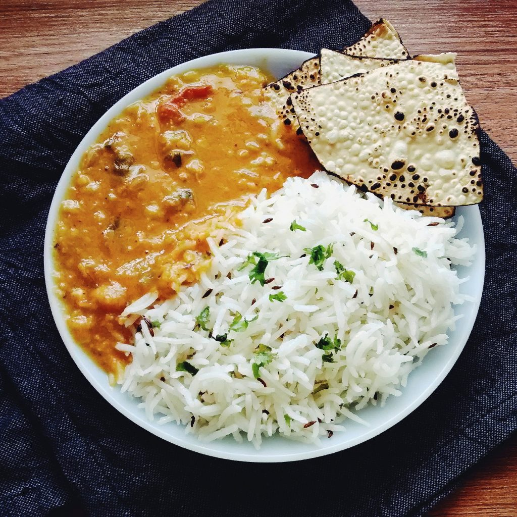 Plate with rice, dal and papad