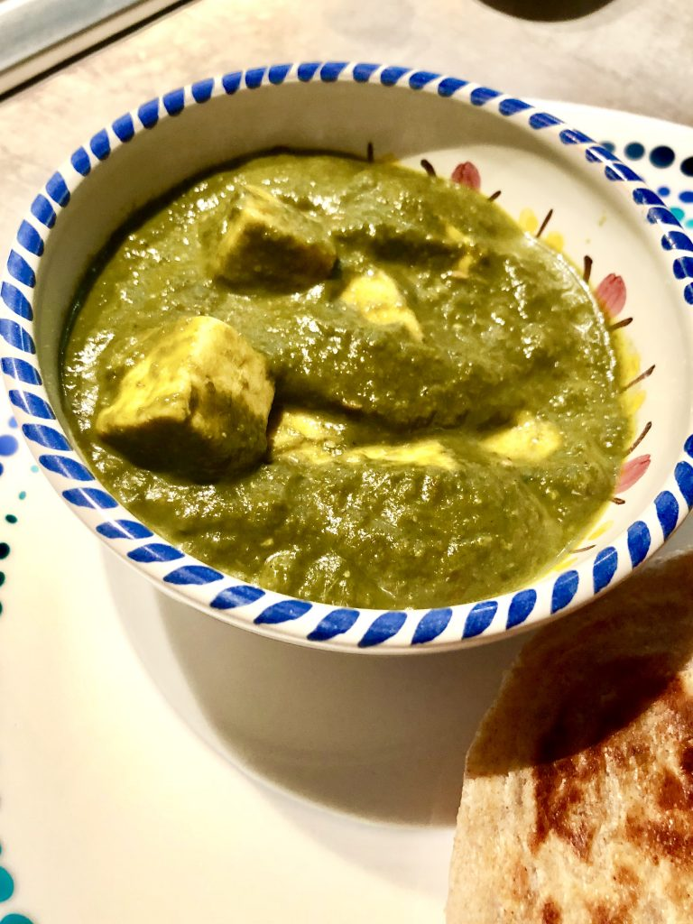 Paneer or cottage cheese cubes in a spinach curry