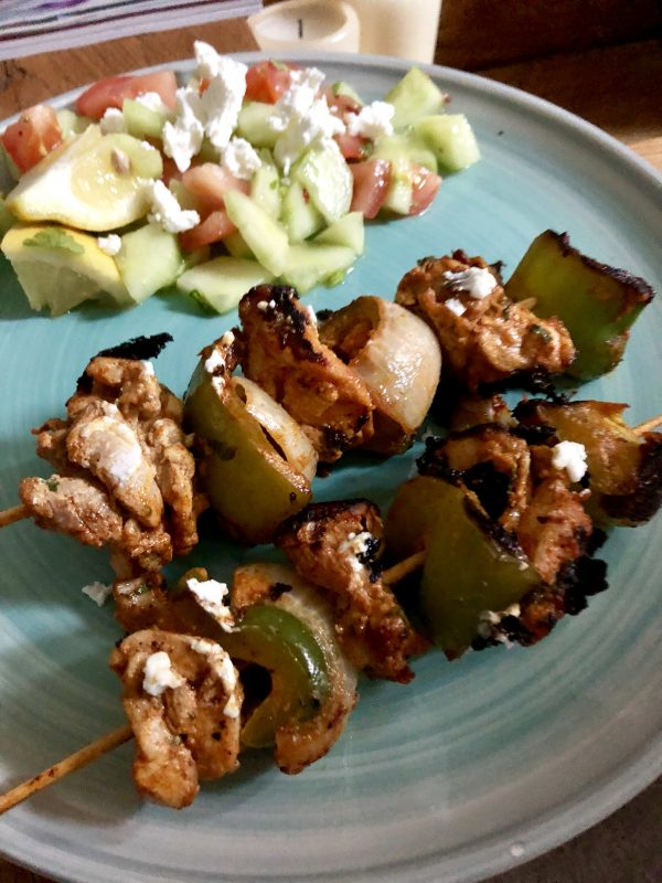 grilled chicken skweres on a blue plate with salad