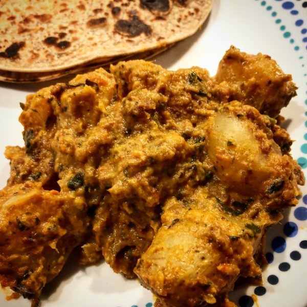 New Potatoes in a curry served with rotis