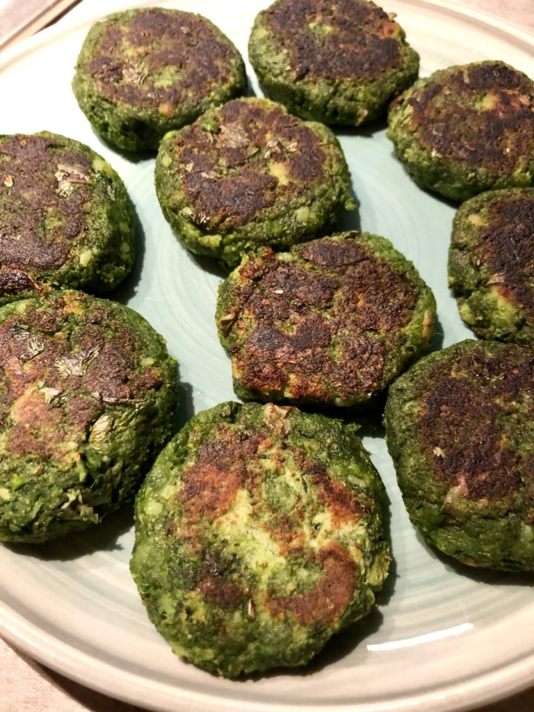 Green plate with hara bhara kebabs on it