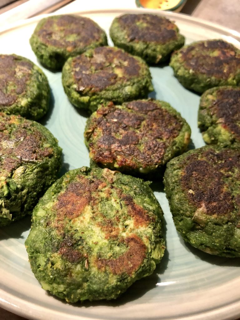 Hara Bhara kebab spinach and peas cutlets on a green plate