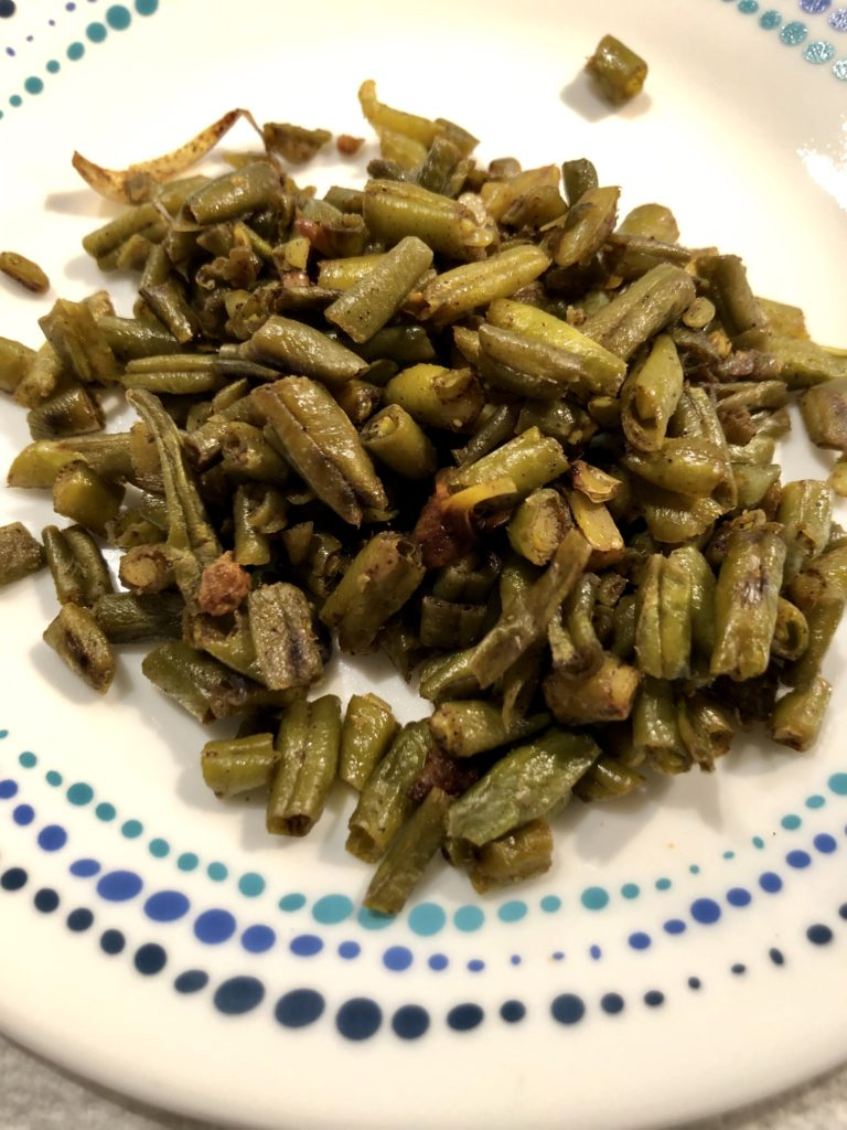 French beans in a Konkai style on a white plate