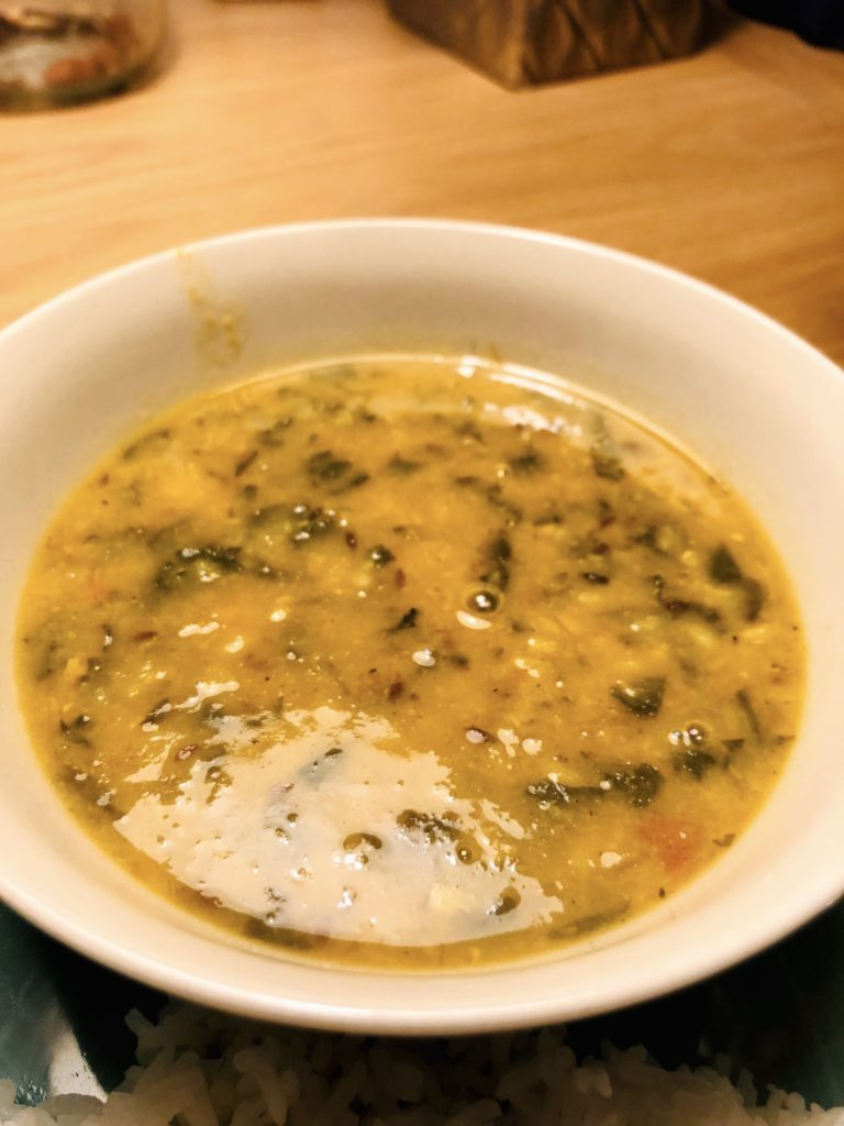 Palak dal in a cream bowl