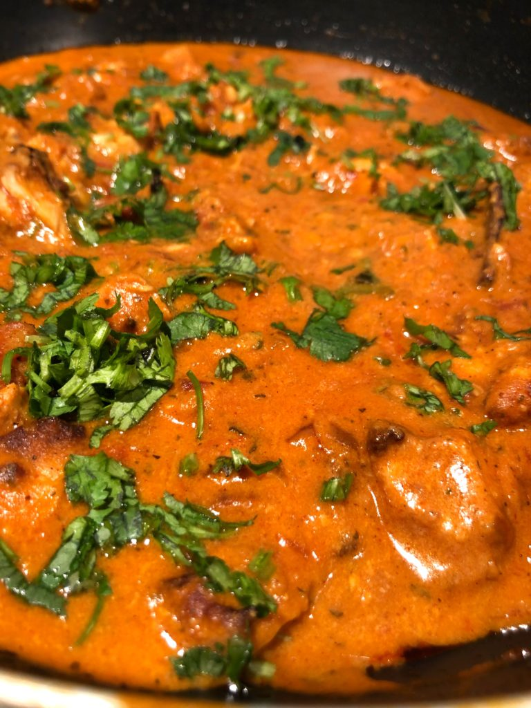 Butter chicken a tangy buttery chicken dish garnished with coriander leaves