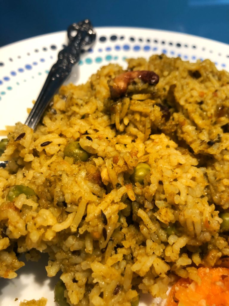 Masale Bhaat - a fragrant rice dish served alongside a carrot salad