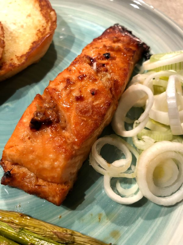 Soy sauce, garlic and honey marinated Itsu styled Salmon with spring onions and asparagus