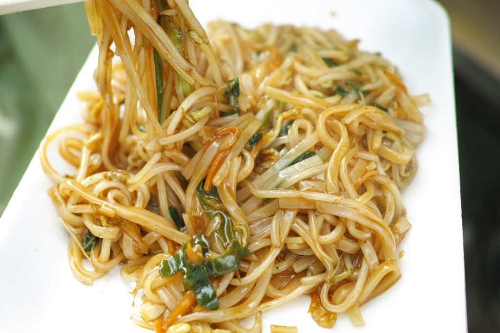 Noodles with ginger scallion and soy saucepan white dish